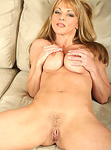 Hot momma Shayla Laveaux spreads her legs wide open to flaunt her pink pussy on the couch