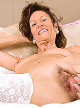 Mature milf India loves playing with her pussy with a pink dildo until she explodes in orgasm