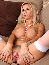 Cunt Shaving, Beautiful blonde Anilos lady shows off her big breasts and juicy milf pussy