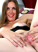 Hairy Pics: Laila flaunts her mature tits and spreads her legs wide open on the couch