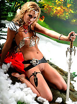 Sexy topless blonde amazon babe posing with two swords and masturbates